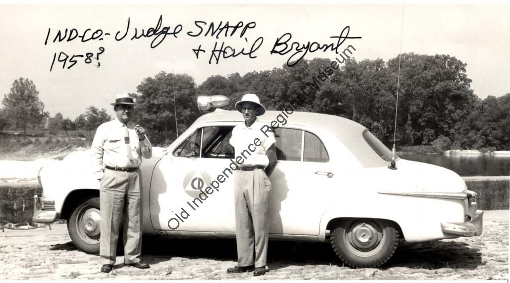 Judge Snapp and Hail Bryant pictured beside the official Civil Defense car