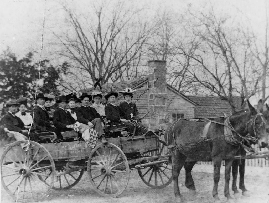 Jamestown residents seated in a wagon