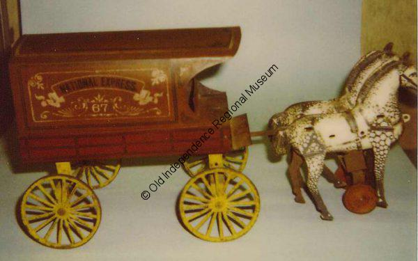 Tin toy wagon with two horses